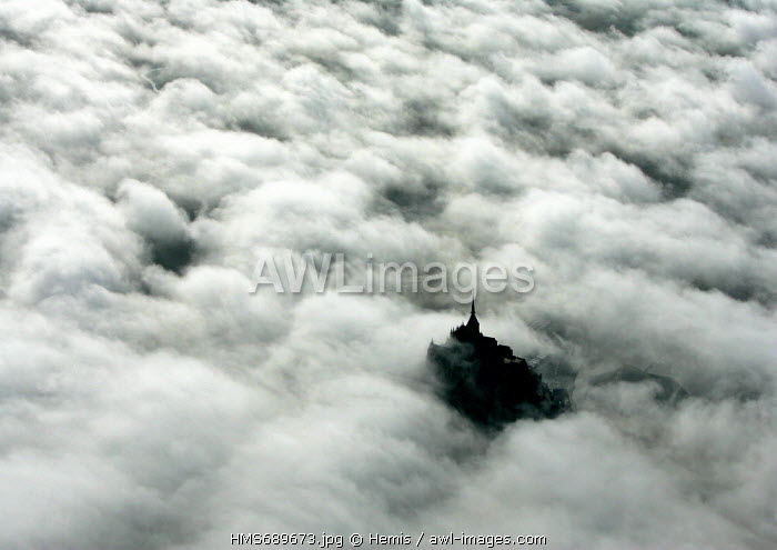 France, Manche, Bay of Mont Saint Michel, listed as World Heritage by UNESCO, Mont Saint Michel in the unlimitedness of mists (aerial view)