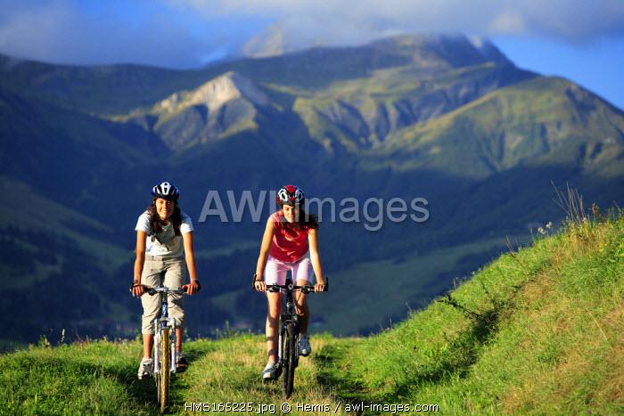 France, Savoie, Mountain bike in Valmorel, Cheval Noir Mountain in the Background