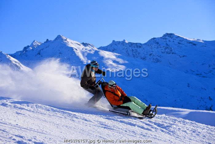 France, Savoie, Meribel, Massif de La Vanoise, Tarentaise, view over Mont du Vallon (2951m), domaine des 3 Vallees skiing resort, ski taxi for able bodied people and disabled people, for some amazing sensations coming back from an altitude restaurant or simply a trip