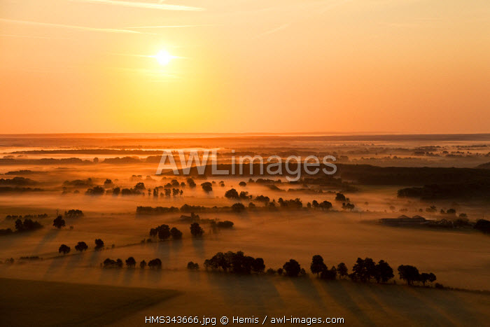 France, Orne, Parc naturel regional du Perche, sunrise in the countryside of Feings (aerial view)
