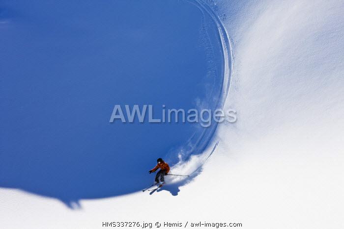 France, Savoie, Trois Vallees ski area, Meribel, skiing on powder snow