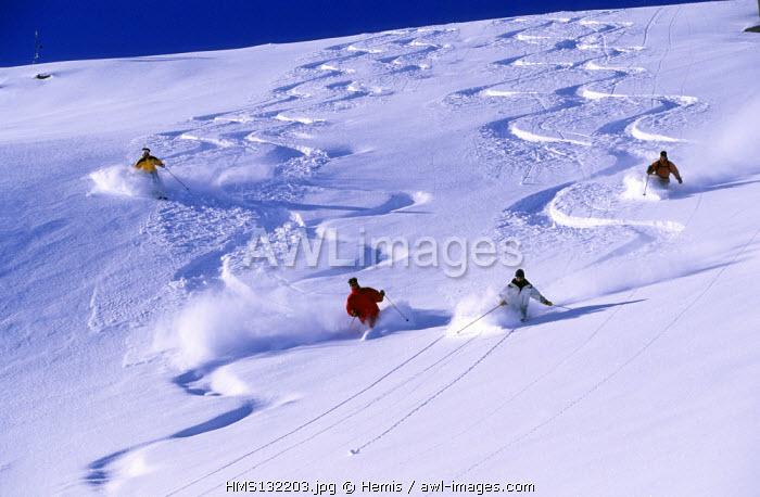 France, Savoie, Meribel, skiers in the Trois Vallees skiing area