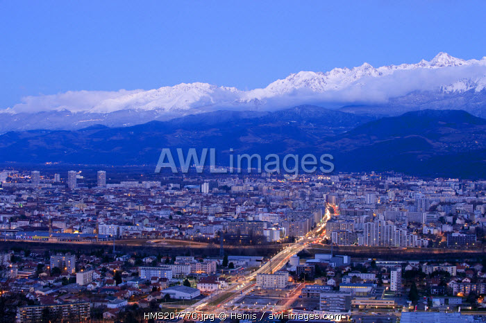 France, Isere, sunset on Grenobleand the Belledonne massif in the background