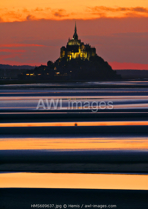 France, Manche, Bay of Mont Saint Michel, listed as World Heritage by UNESCO, Mont Saint Michel in the sunset