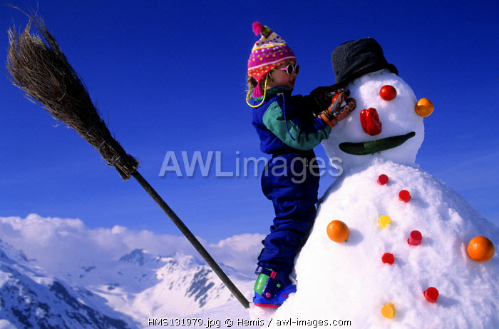 France, Savoie, Valmorel ski resort, child playing in snow