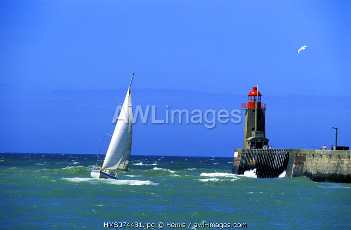 France, Seine Maritime, Pays de Caux, Cote d'Albatre, Fecamp, a sailling ship exceeding the port entrance beacon