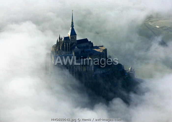 France, Manche, Bay of Mont Saint Michel, listed as World Heritage by UNESCO, the Mont Saint Michel, ship in mists