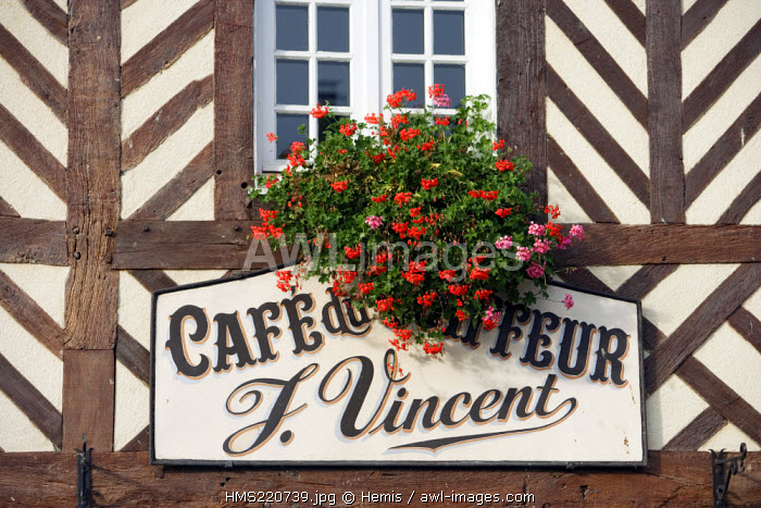 France, Calvados, Pays d'Auge, Beuvron en Auge, detail a half timbered house in the village, Cafe du Coiffeur sign