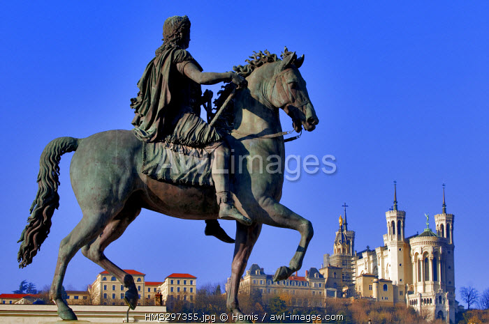 France, Rhone, Lyon, historical site listed as World Heritage by UNESCO, equestrian statue of Louis XIV on place Bellecour (Bellecour square) and Notre Dame de Fourviere's Basilica
