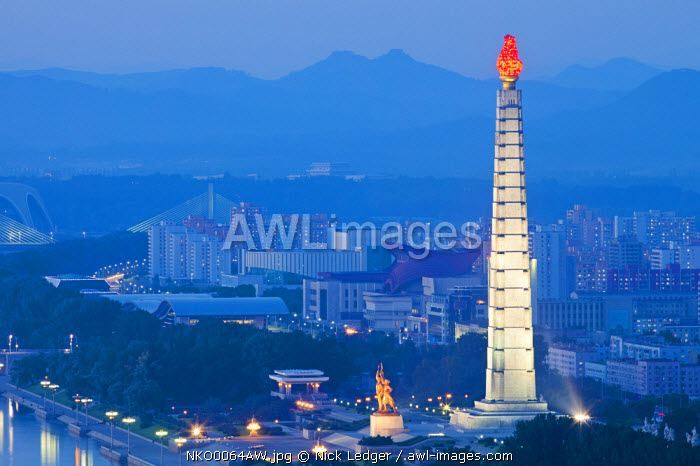 Democratic People's Republic of Korea, North Korea, Pyongyang. View of the Juche Tower and Taedong River from the Yanggakdo Hotel.