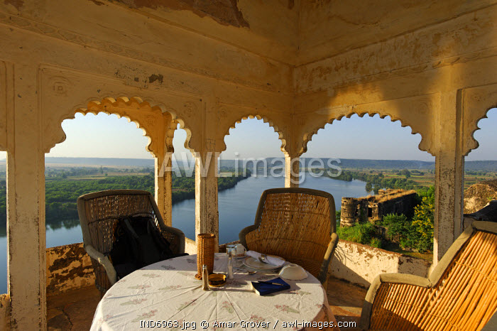 India, Rajasthan, Bhainsrorgarh. Now adapted as a heritage hotel, the roof terrace and dining area of Bhainsrorgarh Fort and Palace lends lovely views over the Chambal River.