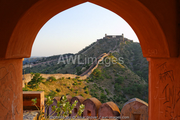 India, Rajasthan, Jaipur, Amber. Viewed from a watchtower on the long crenellated walls surrounding Amber Fort, the lofty walls of the Charbagh gardens in neighbouring Jaigarh Fort top a barren ridge.