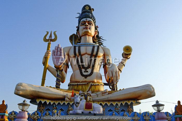India, Madhya Pradesh, Omkareshwar. A huge statue of the Hindu god Shiva, known as the Shiv Pratima, dominates the Maa Rajrajeshwari temple at Omkareshwar, an island in the Narmada River.