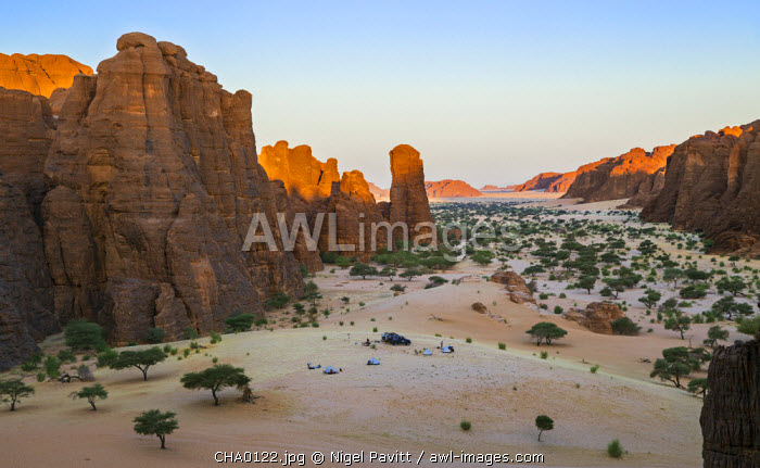 Chad, Bechike, Ennedi, Sahara. A temporary tourist camp surrounded by weathered Palaeozoic sandstone in the Bechike Valley.