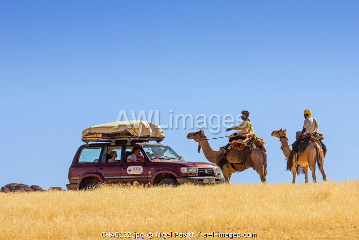 Chad, Bechike, Ennedi, Sahara. Toubou nomads explain a cross-country route to tourists.