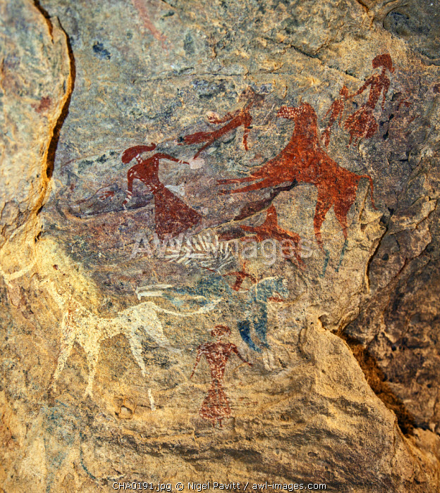 Chad, Terkei West, Ennedi, Sahara.  An ancient Bichrome rock art panel of women with elaborate hairstyles and horses.