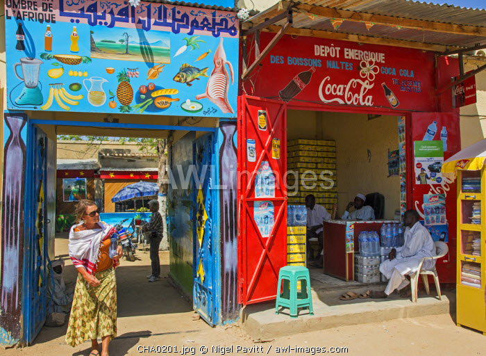 Chad, Abeche, Ouaddai, Sahel.  Tourists leave the small restaurant L�Ombre D�Africque in Abeche, Chad�s fourth largest city.