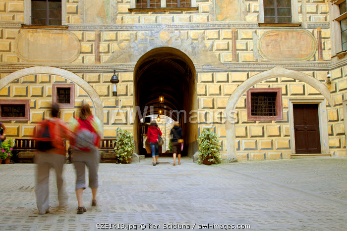 Central and Eastern Europe, Czech Republic, South Bohemia, Cesky Krumlov. Tourists walking inside the castle courtyard