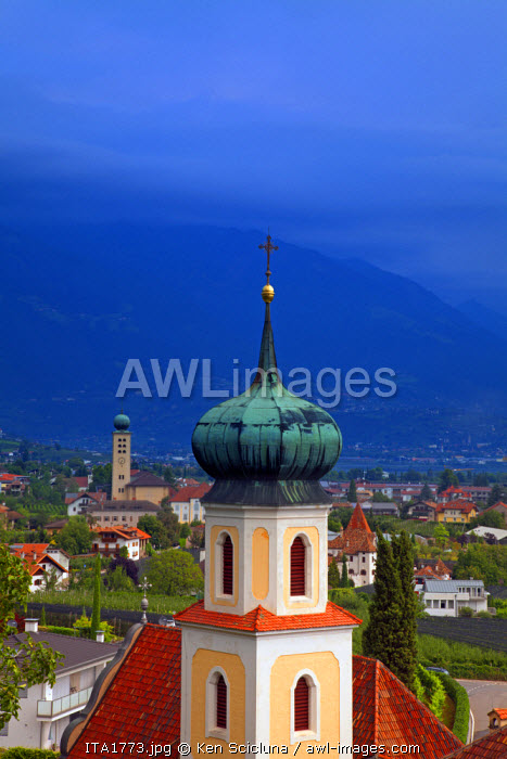 Northern Italy, Trentino, Alto Adige, Sud Tyrol. A bell tower from the church of a monestary overlooking the small town of Lana and mountains