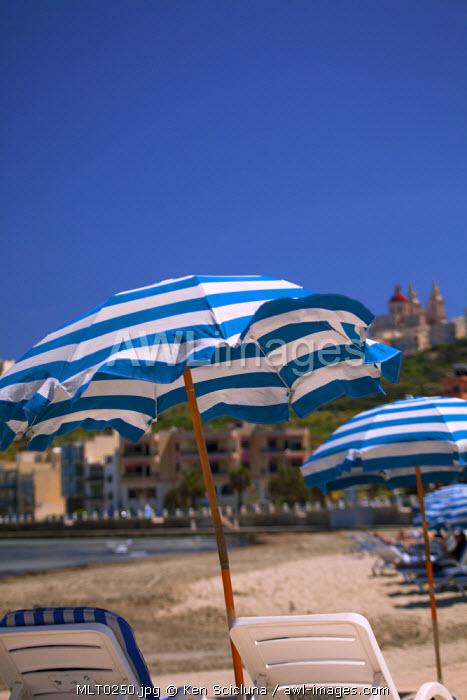 Mediterranean Europe, Malta. Umbrellas on Mellieha Bay