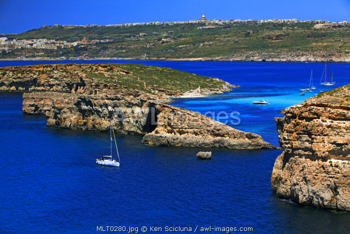 Mediterranean Europe, Maltese Islands, Comino. Overview of parts of Comino, the Blue Lagoon and Gozo in the distance