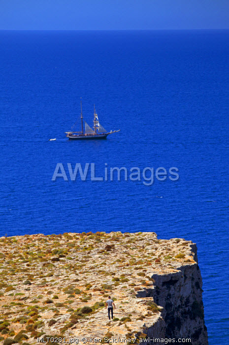 Mediterranean Europe, Maltese Islands, Comino. A sail ship sailing close to the cliffs in Comino
