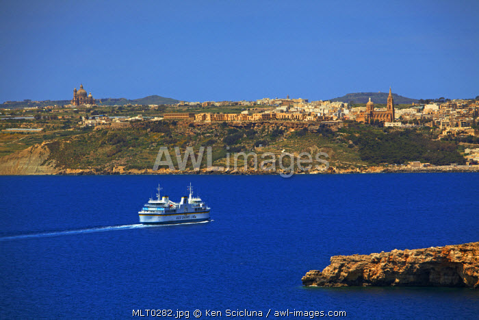 Mediterranean Europe, Maltese Islands, Comino. The Gozo Channel Ferry crossing between the islands in the distance with Gozo visible in the background