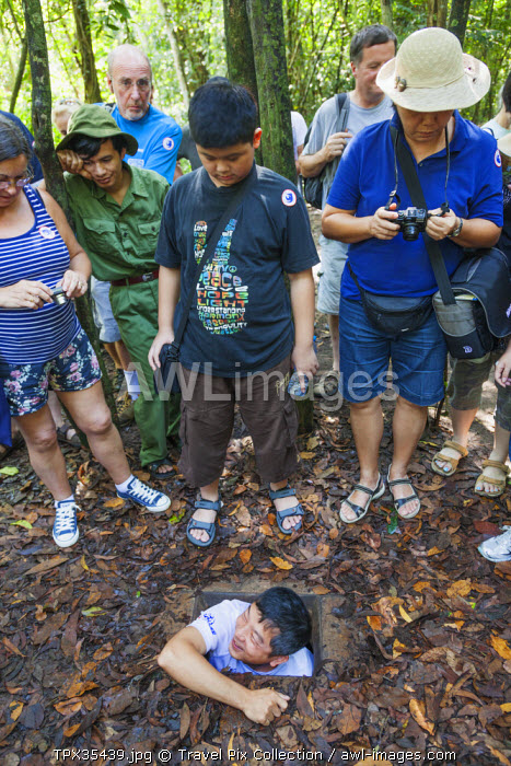 Vietnam, Ho Chi Minh City, Cu Chi Tunnels, Tourists Emerging from Underground Tunnel