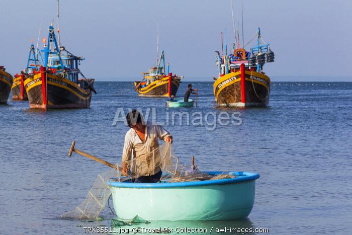 Vietnam, Mui Ne, Mui Ne Beach, Fisherman in Coracle Fishing Boat