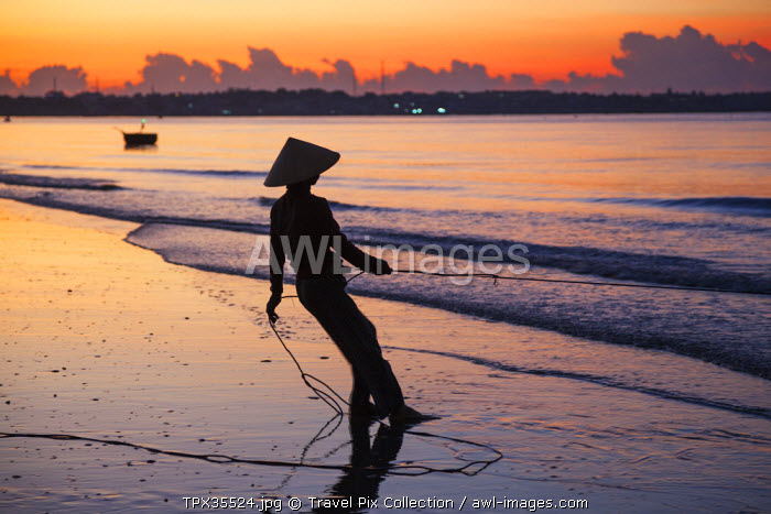 Vietnam, Mui Ne, Mui Ne Beach, Net Fisherwoman at Dawn
