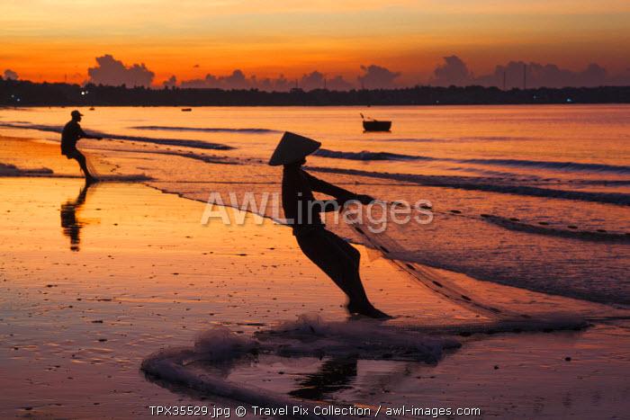 Vietnam, Mui Ne, Mui Ne Beach, Net Fisherwoman at Dawn