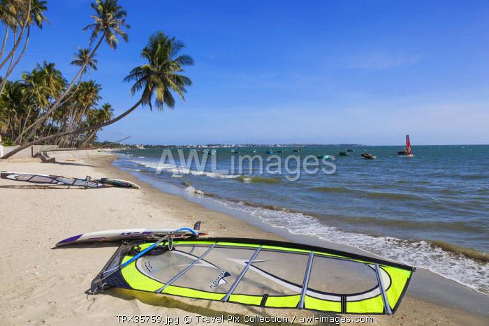 Vietnam, Mui Ne, Mui Ne Beach, Windsurfing Sail and Board on Beach