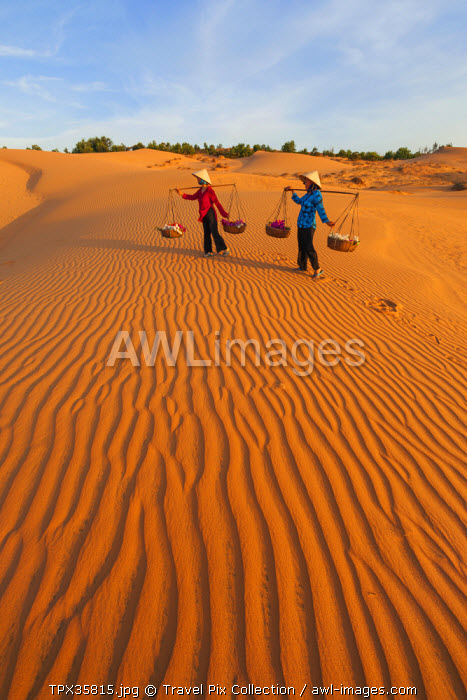 Vietnam, Mui Ne, Sand Dunes and Local Women in Conical Hats