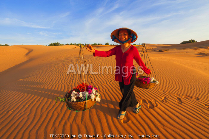 Vietnam, Mui Ne, Sand Dunes and Local Woman in Conical Hat