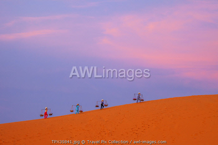 Vietnam, Mui Ne, Sand Dunes, Local Women in Conical Hats at Dawn