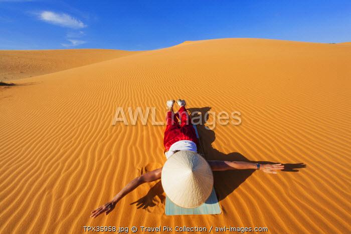 Vietnam, Mui Ne, Sand Dunes, Tourist Sliding on Dunes