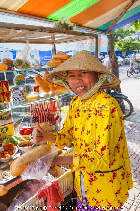 Vietnam, Nha Trang, Roadside Food Vendor Selling Baguette Sandwiches