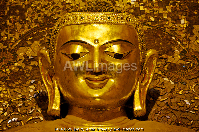Myanmar, Burma, Mandalay Region, Bagan. In the heart of Ananda Pahto, or Ananda Temple, stand four gilded teak statues of the Buddha.
