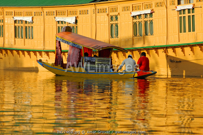India, Jammu & Kashmir, Srinagar. Small wooden boats are often used by tourists to access Dal Lake's celebrated houseboats and by locals to cross sections of the lake and its nearby channels.