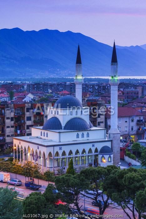 Albania, Shkodra, elevated view of Zogu 1 Boulevard and mosque, dusk