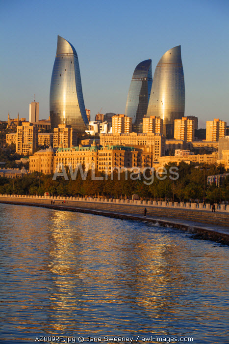 Azerbaijan, Baku, View of the Flame Towers reflecting in the Caspian Sea