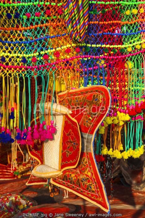India, Rajasthan., Pushkar, Stall selling camel decorations and embellishments at Pushkar Camel Fair