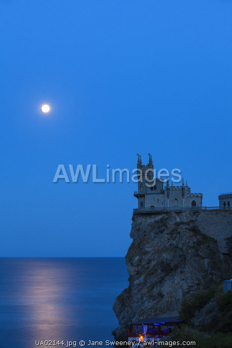 awl-images.com - Ukraine / Ukraine, Crimea, Yalta, Gaspra, Full moon over shines over The Swallow's Nest castle perched on Aurora Clff