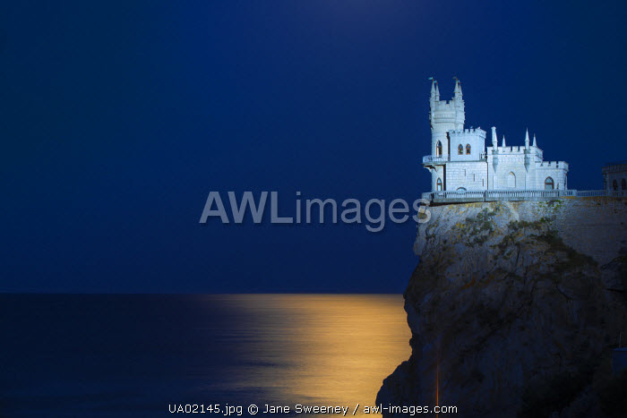Ukraine, Crimea, Yalta, Gaspra, Full moon over  shines over The Swallow's Nest castle perched on Aurora Clff