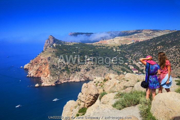 Ukraine, Crimea, Balaklava, Tourists looking at Sea entrance to Balaklava bay