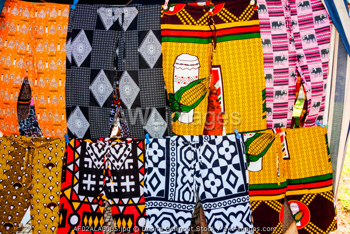 Africa, Angola, Benguela. Brightly colored pants for sale at local shop.