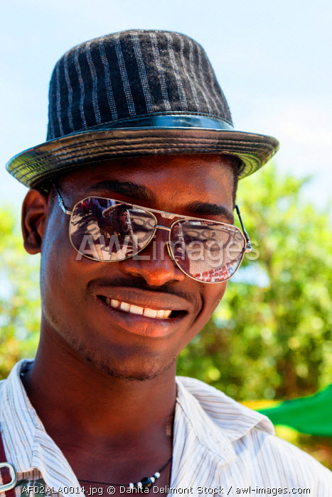 Africa, Angola, Benguela. Portrait of young man in hat and sunglasses.