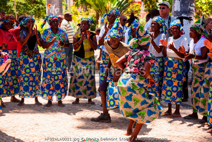 Africa, Angola, Benguela. Women and men dancing in traditional dress.