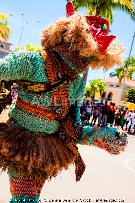 Africa, Angola, Lobito. Man performing traditional Tchingange dance for tourists.