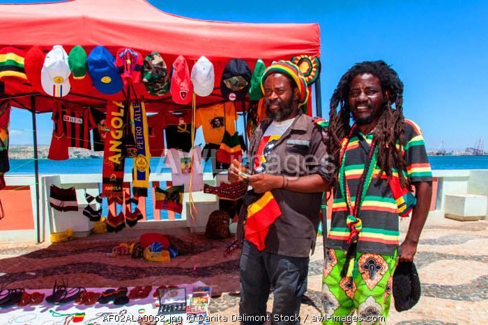 Africa, Angola, Lobito. Rastafarian men at their streetside shop.